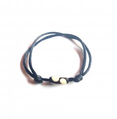 Bracelet: Black thick cord with sliding knots and bone oval bead