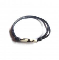 Bracelet: Black thick cord with sliding knots and bone long bead