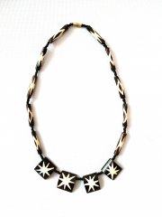 Black and white necklace made of bones